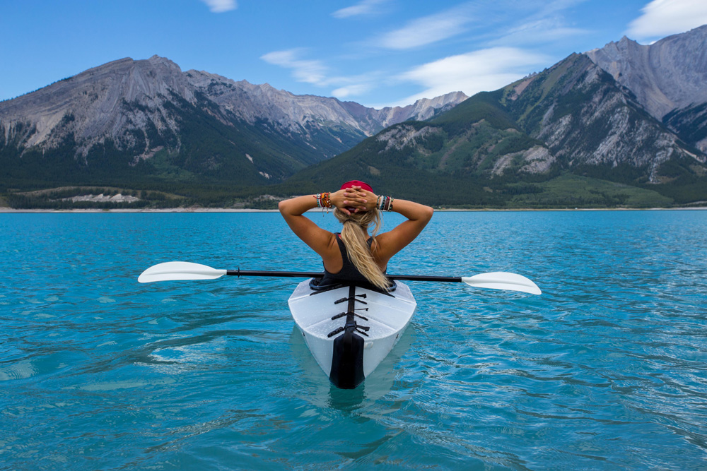 worklife-how-to-make-it-in-business-girl-thinking-in-canoe