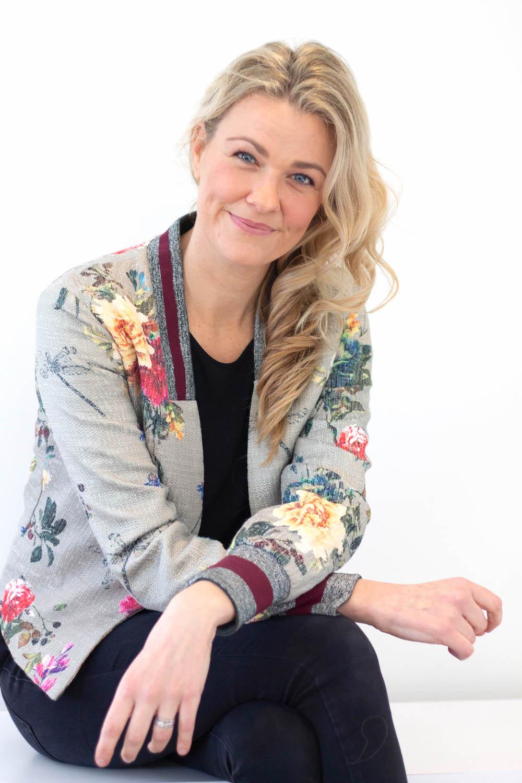 blonde in flowery jacket