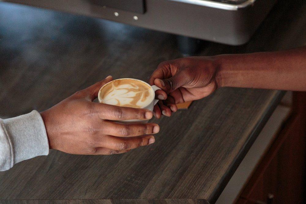 handing a coffee